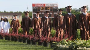 Cumberland Reg Graduation: Graduates pass 2014 lit on the scoreboard while entering the athletic field for the graduation ceremony. Monday June 23 2014 Cumberland Regional High School Graduation. (The Press of Atlantic City / Ben Fogletto) - Ben Fogletto