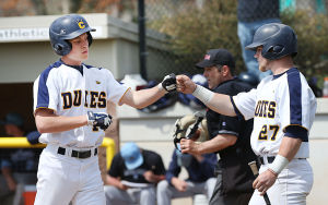 Cumberland County Baseball: Cumberland 14 Cody Stashak is congratulated by teammate 27 Devin McCann after scoring during the first inning. Sunday April 13 2014 Middlesex County College at Cumberland County College Baseball. (The Press of Atlantic City / Ben Fogletto) - Ben Fogletto