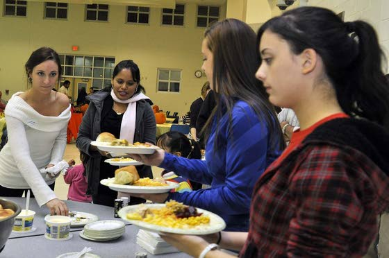 Three MTHS clubs join to stage dinner for Caring for Kids clients