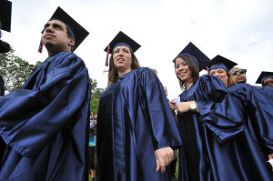ACCC GRADUATION: Grads arrive on May 23 during the Atlantic Cape Community College Commencement in Mays Landing. College loan debt continues to grow in the state, a study shows. - Photo by Michael Ein