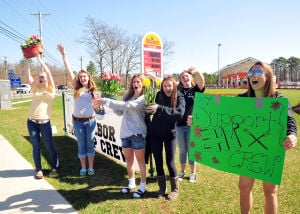 EHT A7 Enterprise: EHT High School Girls Crew Team's Cailyn Casto, 16, holds a support sign, as teammates (left/right) Stephanie Hauck, 17, Taylor McHugh, 16, Michelle Miller, 16, Lauren Baruffi, 15, and Mackenzie Logue, 15, all from EHT, scream and howl to by passers during the Egg Harbor Township High School Girls Crew Flower Sale held at the WaWa on the corner of English Creek and Ocean Heights Ave. in EHT Friday April 2, 2010. Photo/Dave Griffin - Dave Griffin