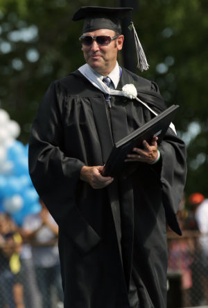 Oakcrest Graduation: History teacher Doug Cervi receives recognition for his career during the Oakcrest High School graduation, Friday June 20, 2014, in Mays Landing. - Michael Ein