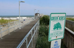 Open Space: A sign designates the pier as a Green Acres site. Monday July 29 2013 Ventnor Pier related to open space measure that was up for a vote in the senate on Monday. (The Press of Atlantic City / Ben Fogletto) - Ben Fogletto
