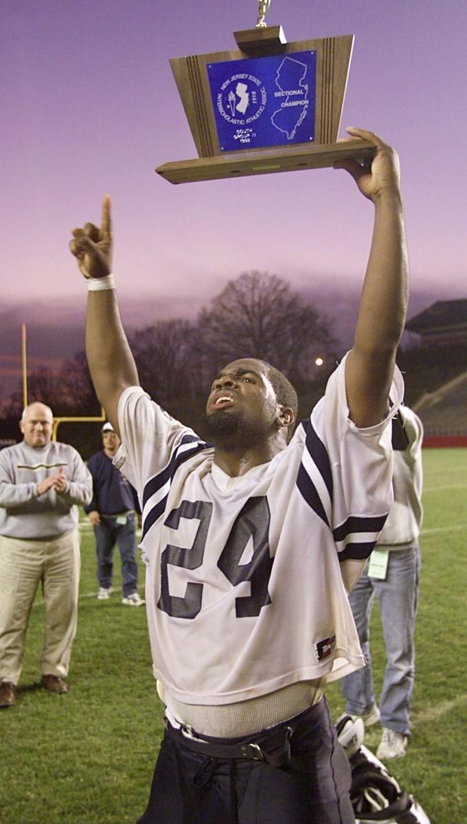 Jamar Reynolds with trophy 1999 Atlantic City football