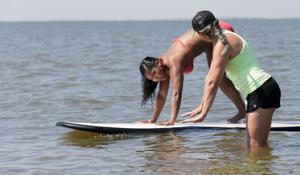 Family bonds grow with yoga fundraiser