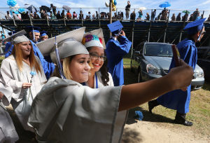 Oakcrest Graduation: Victoria Clark, 18, and Sharon Aguirre, 17, take a selfie during the Oakcrest High School graduation, Friday June 20, 2014, in Mays Landing. - Michael Ein