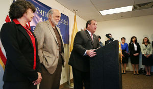 Christie Single Point Of Entry: (l-r) Atlantic Homeless Alliance director Ann Thoresen, Atlantic County Executive Dennis Levinson and Gov. Chris Christie speak during the press conference. Tuesday May 6 2014 NJ Gov. Chris Christie meets with with Organization representatives involved with the Single Point of Entry Program at the Atlantic County Municipal Building in Atlantic City. (The Press of Atlantic City / Ben Fogletto) - Ben Fogletto