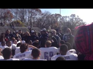 Atlantic City coach Thomas Kelly accepts the Boyd-Marczyk Trophy on Thanksgiving Day 2012.
