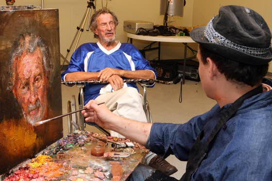 Every portrait has a storyPainter and  filmmaker work on project at A.C. Rescue Mission