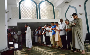 RAMADAN STARTS: Prayer is led by the Imam. Tuesday July 9 2013 Prayers begin to mark Ramadan at Masjid At-Taqwa in Atlantic City. (The Press of Atlantic City / Ben Fogletto) - Ben Fogletto