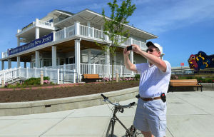 Welcome Centers: Visitor Bruce Lockyer of Langhorne, Pa., uses his phone camera to take pictures outside the new welcome center. Saturday June 22 2013 Ocean City Welcome Center on the Rt. 52 Causeway. (The Press of Atlantic City / Ben Fogletto)  - Photo by Ben Fogletto