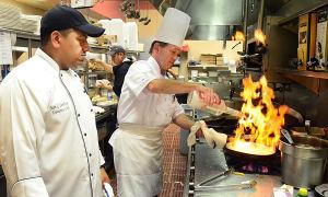 Y23 HTMI Gourmet: Friday July 12 2013 Chefs Juan Santiago of Ventnor (left) and Robert Bell of Ocean City prepare Polo DiVodka at Gourmet Italian restaurant in Galloway. (The Press of Atlantic City / Ben Fogletto) - Ben Fogletto