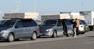 PIF FURNITURE GIVEAWAY: Donated mattresses are loaded on vehicles at Sandcastle Stadium, in Atlantic City, Wednesday Nov. 14, 2012, in an effort to help Atlantic City school families affected by Hurricane Sandy, coordinated by Atlantic City schools working with Cooper Levenson law firm.