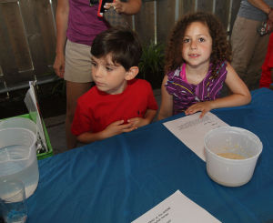 Acbp Y10 Challah Baking Class: Cousins Aidan, 5, and Lauren Silverman, 6, listened to instructions on how to make challah. - kristian gonyea