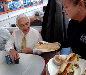 Lautenberg: Sen. Frank Lautenberg (left) is served by waitress Terrie Martire of Absecon at White House Subs in Atlantic City -- U.S. Sen. Frank Lautenberg campaigns for reelection in Atlantic City Tuesday October 7 2008. (The Press of Atlantic City / Ben Fogletto)  - Ben Fogletto