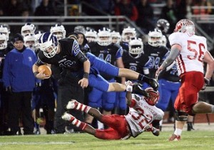 Hammonton Photo: St. Joseph High School's Miles Pease tackles Hammonton's Christian Mortellite on Wednesday night at Hammonton High School.  - Photo by Edward Lea
