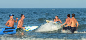 Tri-Resorts: Upper's Taylor Hennessy (center) prepares to dismount her board during the Paddle Board Relays. Monday July 15 2013 Tri-Resorts Lifeguard Championships in Strathmere. (The Press of Atlantic City / Ben Fogletto) - Ben Fogletto