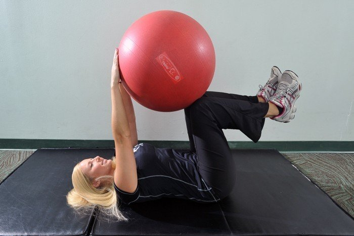 your workout  stability ball dead bug