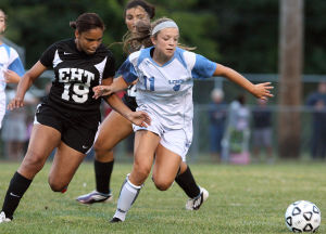 LCM Girls Soccer: Lower's Gabrielle McKeown (11) advances the ball in front of Danielle Henry (19) of Egg Harbor Twp. Lower Cape May Regional vs. Egg Harbor Township girls soccer played in Lower Cape May. Monday Sept. 09, 2013,. (Dale Gerhard Photo/Press of Atlantic City) - Dale Gerhard