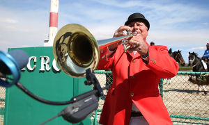 Day At The Races: Racetrack bugler Richard Garrick of Oceanville signals the beginning of the race. Sunday April 27 2014 Live turf racing at the Atlantic City Racecourse in Mays Landing. (The Press of Atlantic City / Ben Fogletto) - Ben Fogletto