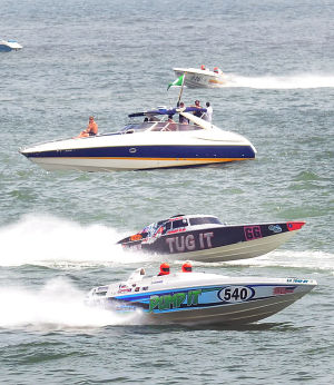AC Power Boats: Sunday June 23 2013 Atlantic City Offshore Grand Prix powerboat race off the beach in Atlantic City. (The Press of Atlantic City / Ben Fogletto)  - Photo by Ben Fogletto