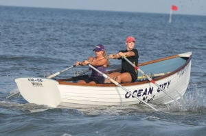 Women Lifeg: Ocean City's Rachel Boudart Holly Berenotto take the lead in Sprint Doubles row during Ocean City Beach Patrol Women's Invitational Wednesday, July 24, 2013. - Photo by Edward Lea