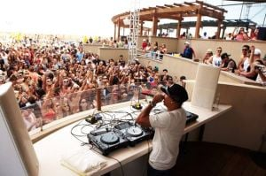 Five Things You Need To Know About HQ Beach Club: Above, DJ Chuckie fuels the dance floor at HQ Beach Club at Revel. At right, the club is Atlantic City's newest spot to see and be seen by the pool.