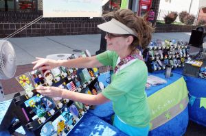 5K Race: Linda Buck of Estell Manor setup her display of La Glas Sea during The Greater Egg Harbor City Chamber of Commerce ever Hometown Saturday, July 6, 2013. The events kicks off the city's annual Hometown Celebration, which is held on the 100 block of Philadelphia Avenue in Egg Harbor City. - Edward Lea