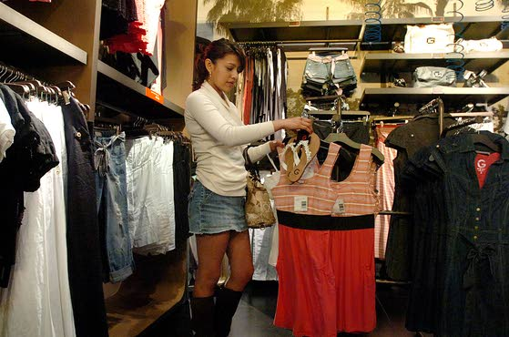 Mary Carrasco of Galloway shops in the dress section at G by Guess inside the Hamilton Mall, Sunday March 21 2010. (The Press of Atlantic City / Ben Fogletto)