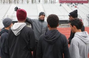 Pleasantville Relay Hoping To Give Coach New Memory At Penn Relays: Pleasantville High School track and field coach Alan Laws Sr. works with members of the Greyhounds' 4x800-meter relay team during practice Tuesday. The relay will run in The Penn Relays Carnival today.