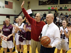 : Wildwood High School girls basketball coach Dave Troiano won his 600th career coaching victory in a win against Cape May County Technical High School. Troiano (center) thanks the fans and his assistant coaches and receives a game ball from principal Chris Armstrong. Tuesday Jan. 29, 2013. (Dale Gerhard/Press of Atlantic City)  - Photo by Dale Gerhard