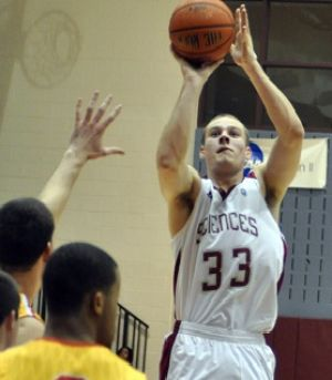 Kerr Photo: Middle Township High School graduate Garret Kerr puts up a shot for University of the Sciences against Chestnut Hill on Feb. 12. Kerr averages 12.6 rebounds per game.  - Heather Weiland