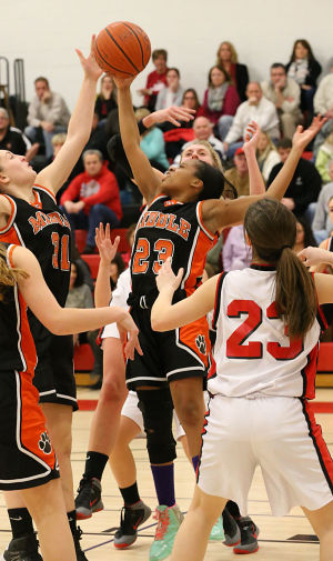 Ocean City Gbb: Middle 32 Lauryn Fields jumps for a rebound during the first half. Monday February 10 2014 Middle Township at Ocean City girls basketball. (The Press of Atlantic City / Ben Fogletto) - Photo by Ben Fogletto