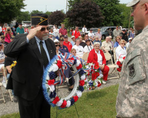 : Ted Mullin (left) of Villas and of the Vietnam Veterans Memorial Society of Philadelphia, presents a wreath during the ceremony. Memorial Day services held at Veterans Cemetery in Crest Haven, Middle Township. Monday May 27, 2013. (Dale Gerhard/The Press of Atlantic City)  - Dale Gerhard