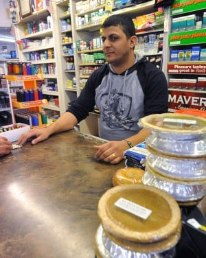 COUNTY VIOLENCE: Jan Habash, manager of Ceder Market, Pleasantville, who grew up in Jordan: 'It's getting worse and worse. Every day is something new. The way we grew up in my country, we were not allowed on the street. I don't want that for my children.'  - Photo by Michael Ein