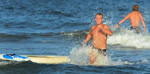 Tri-Resorts: Wildwood's Bryan Byles dismounts his board to win the Paddle Board Relays. Monday July 15 2013 Tri-Resorts Lifeguard Championships in Strathmere. (The Press of Atlantic City / Ben Fogletto) - Ben Fogletto