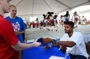 76ers Beach Bash: 76ers' Nerlens Noel signs autographs at the 76ers' Annual Beach Bash at Jack's Place in Avalon, Saturday July 27 2013. (The Press of Atlantic City / Ben Fogletto) - Photo by Ben Fogletto