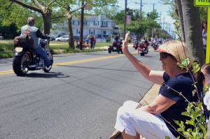 Memorial Day Parade S. Point: Linda Rihl, of Somers Point, waves to parade participants, Monday May 27, 2013, during the Somers Point Memorial Day parade. (The Press of Atlantic City/Staff Photo by Michael Ein)  - Michael Ein