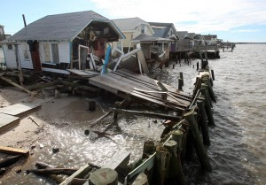 : Damaged homes on South Beach Ave on the Delaware Bay in Reeds Beach, Middle Township. Residents of Cape May County deal with the clean-up in the wake of Hurricane Sandy. Wednesday Oct. 31, 2012. (Dale Gerhard/Press of Atlantic City)  - Photo by Dale Gerhard
