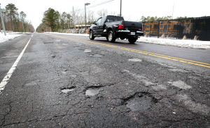 Pothole Map: Cars travel through potholes on Millville Ave near Rainbow Drive in Mays Landing. Tuesday March 4 2014 (The Press of Atlantic City / Ben Fogletto) - Ben Fogletto