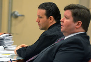 LATKO: Patrick Latko and attorney Kevin Moses, right, listen to testimony during Latko's murder trial in Mays Landing. Latko was found guilty Wednesday of killing Diana Patterson, 64, and her 29-year-old son, Ryan, inside their Hammonton home on Nov. 3, 2011.  - Michael Ein
