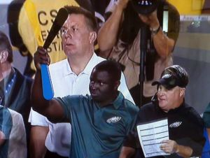 Eagles Embrace Signaling Invention By Ventnor Native: Philadelphia assistant R.J. Harvey stands next to head coach Chip Kelly, right, and uses the Signalfan during the game vs. the Redskins.
