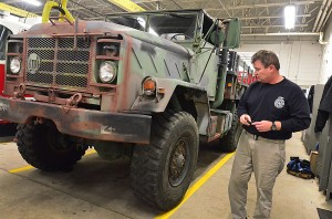 Leveraging The Storm: Brigantine aActing Fire Chief Jim Holl walks past the newly acquired Army surplus truck that has been refurbished after stints in Iraq and Kuwait.  - Ben Fogletto