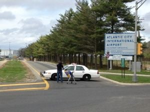 Atlantic City Airport Bomb Threat: A N.J. State Trooper stands guard at Amelia Earhart Drive outside Atlantic City International Airport Friday afternoon. The airport has been evacuated after a suspicous package was found in the bathroom.  - Photo by MIKE EIN