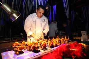 F21 Menrcookin: Chef Ruben Espinal of Resorts Casino Hotel set up his Surf and Turf during 13th annual Men R' Cookin' event, a fundraiser for the Boys & Girls Club of Atlantic City at Pool at Harrah's Thursday, Feb 20, 2014. - Edward Lea