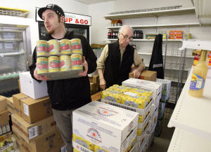 Polar Plunge: Giovanni Ciro, left, of Mays Landing and Nick Ricci, of Sea Isle City, take stock of hundreds of pounds of groceries, meats, cheeses and cases of drinks at Giovanni's Deli on Landis Avenue.  - Dale Gerhard