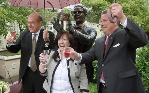 : Tom Scannapieco, (left) developer and owner of the Sheraton in Atlantic City, Janet Espenshade, (center) designer and curator of the Miss American memorabilia at the Sheraton, Jeff Alrecht (left) general manager of the Sheraton toast the Bert Parks statue in the tea garden at the Sheraton. The bronze statue of Miss America icon Bert Parks, was reinstated in the Tea Garden outside the Sheraton Hotel in Atlantic City, Friday June 7, 2013. (Dale Gerhard/The Press of Atlantic City)  - Dale Gerhard