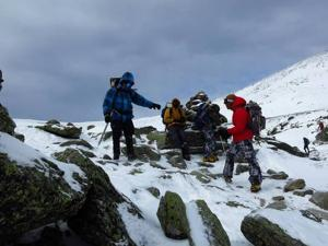 Adventurous Boy Scout troop members trek close to the top of Mt. Washington