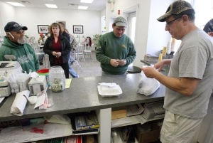 Polar Plunge: Mike Gardinale waits on lunch customers Wednesday at Mrs. Brizzle's on Landis Avenue in Sea Isle City. Sea Isle City's business community briefly emerges from its winter hibernation for the annual polar plunge being held this weekend.  - Photo by Dale Gerhard