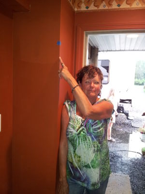 Powerball: Sandy Nickel points to the water line from Hurricane Sandy in her Dock Road home. - Staff photo by Donna Weaver